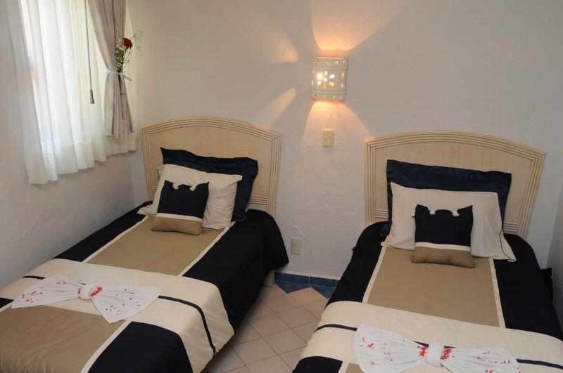 Habitaciones alojamiento en manzanillo hotel marina for Recamaras individuales contemporaneas
